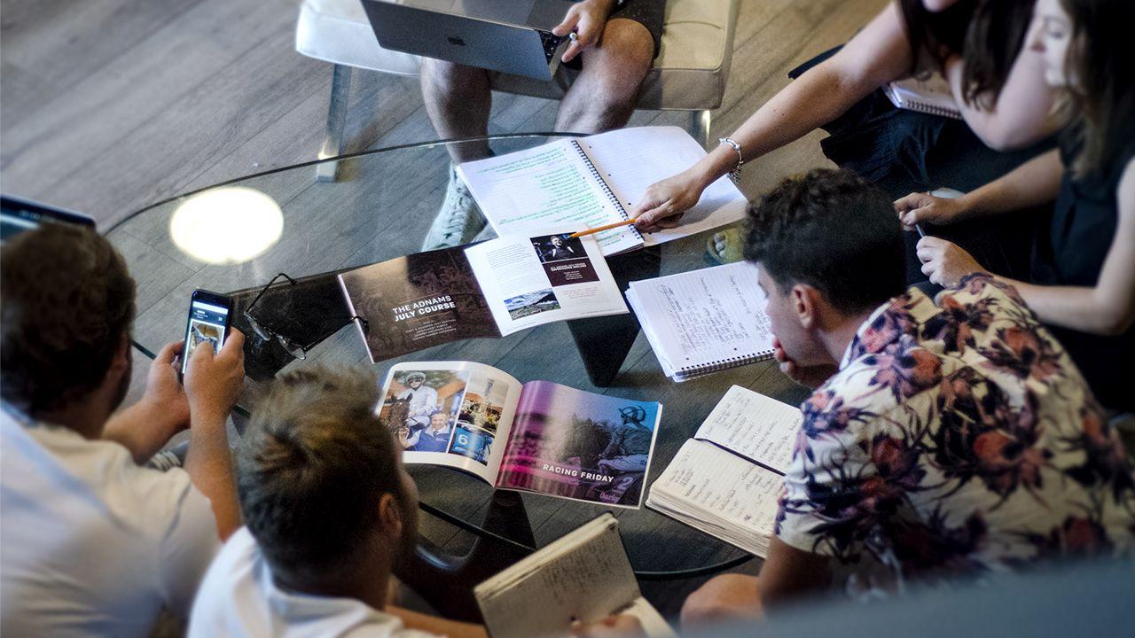 Cubiq design members of staff in a meeting